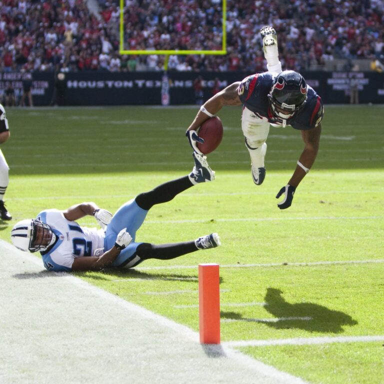 Football player diving forward