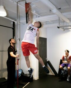 Young athlete testing jump height