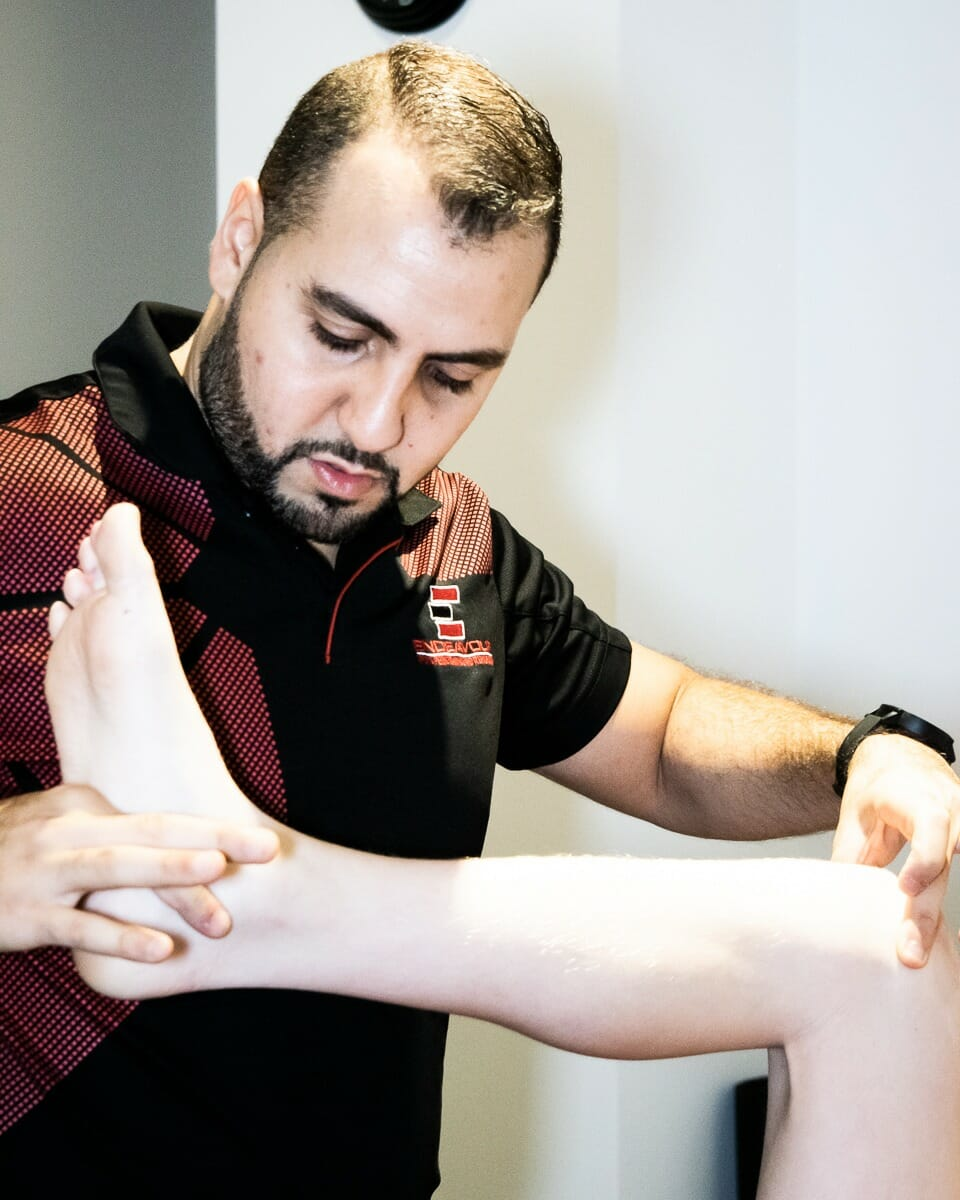 Man analyzing the movement of a lower leg.